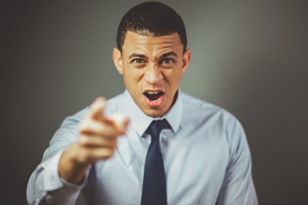 Picture of man pointing and yelling, showing loss of self control.