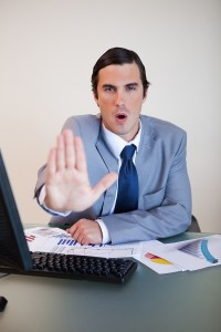 Businessman trying to calm down his upset negotiation partner